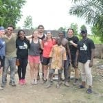 Group of students standing and smiling in Mi Ghana