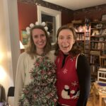 Two girls smiling in Christmas wear