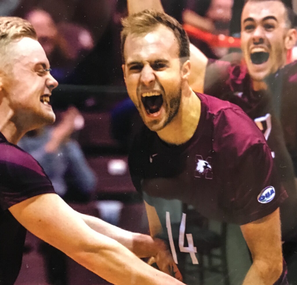 volleyball players celebrating a score